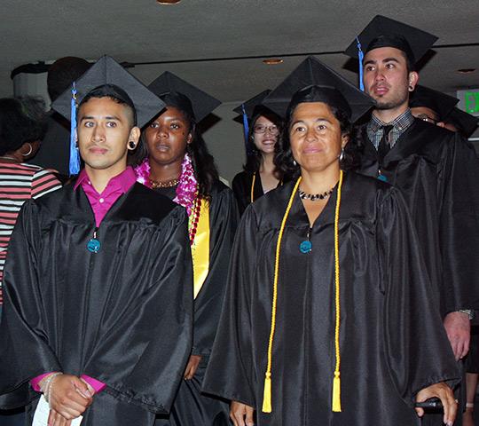 Graduates walking in at ceremony in Zellerbach Hall, UC Berkeley